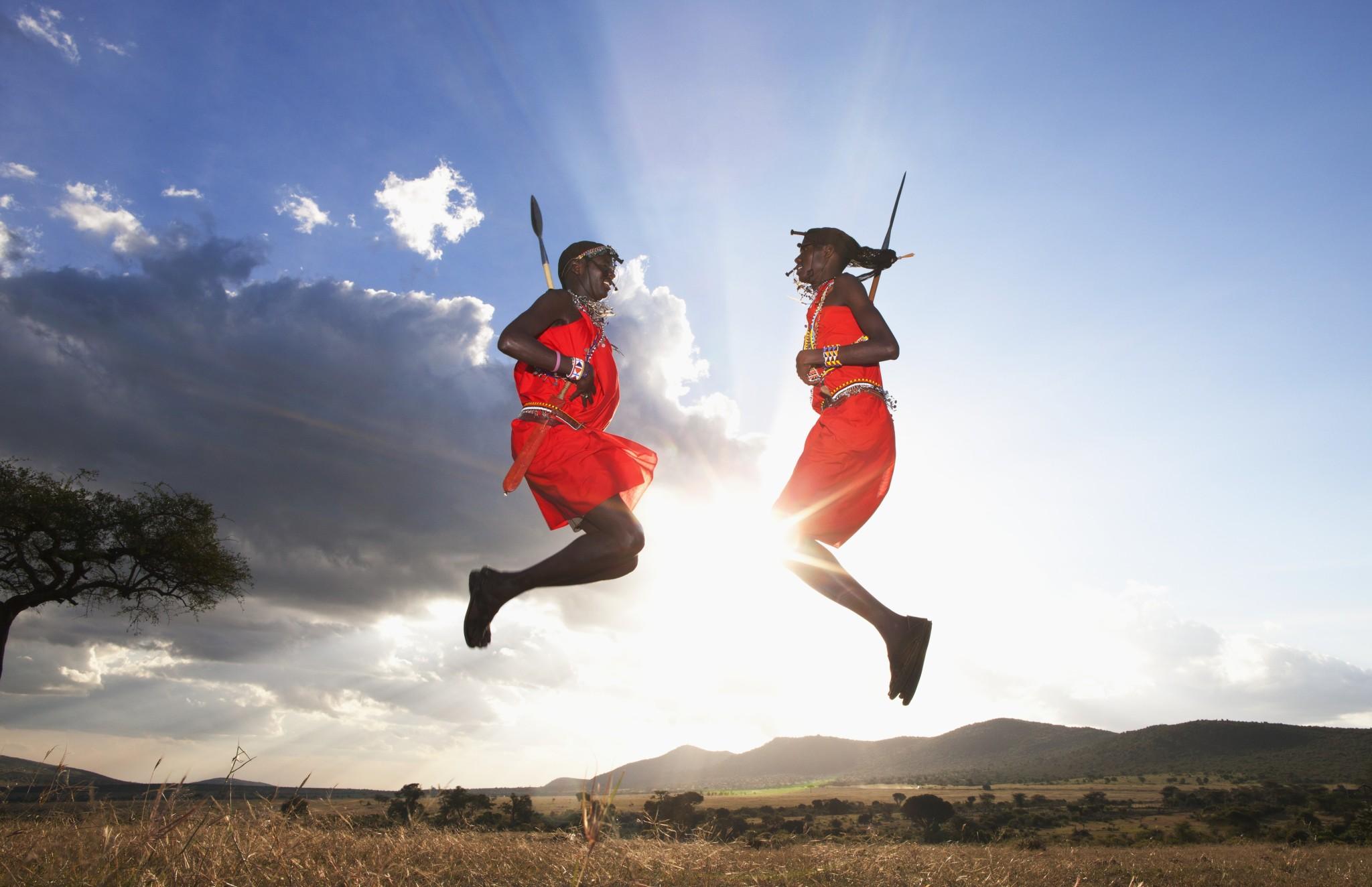 Kenya --- Maasai tribesmen jumping, Maasai Mara, Kenya --- Image by © Hugh Sitton/Corbis