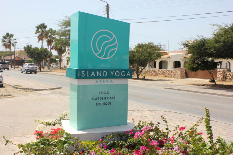 Island Yoga Studio Aruba sign