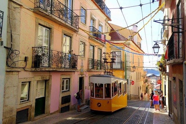 colourful tram on hill Lisbon